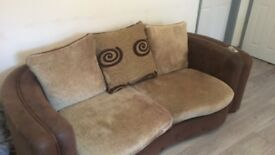 Sofa and leather arm chair
