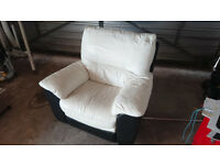 White creme and black leather armchair with electrical recline