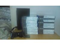 playstation 2 with quite a few games.