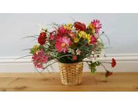 Fake flowers with wicker pot