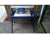 Power Craft electric tile cutter. Water cooled, with stand. Cuts all angles with ease. Used once.