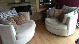 Beautiful 2 round chairs grey with cushions excellent condition they swing round pure BARGAIN