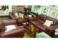 3 piece suite burgundy leather 2 seat sofa and 2 armchairs. High quality leather.