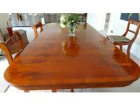 Dining table (6-8) and chairs in polished yew. (cupboards & low tables separately advertised)