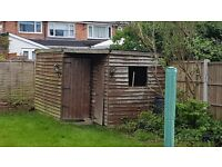 Selling wooden shed free.