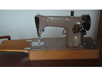 Singer 201K electric sewing machine.