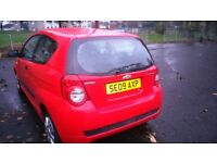 09 RED AVEO, LOW MILEAGE 88000, 3 DR HATCHBACK, LONG MOT END OF JUNE /18, NEW BATTERY