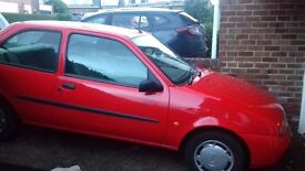 For sale-Extremely LOW MILEAGE-Red Ford Fiesta. ONLY 26, 400 registered miles. Excellent condition