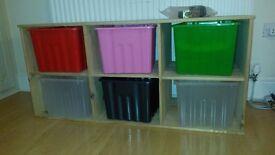 Low wooden storage unit with 6 plastic boxes & castors