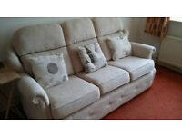 3 seater , oyster coloured sofa on castors