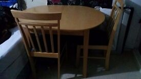extendable real oak dining table with 4 chairs
