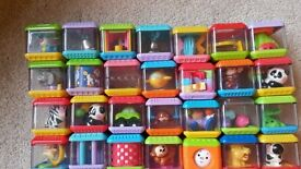 28 x PLASTIC CUBES WITH MINI TOYS INSIDE