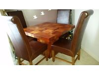 Beautiful dining table and 4 leather chairs