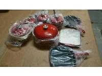A brand be cast iron 8 piece pots and pans set.