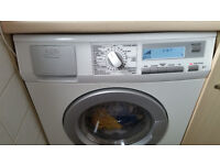 AEG Top Quality German washer dryer. Only 1 year old. Was 680 new. Delivery