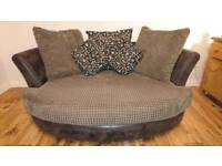Cuddler sofa in like new condition! Complete with 4 matching small cushions (only 2 shown)