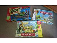 Selection of kids board games Monopoly Scrabble and Skull Island