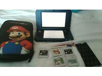 Nintendo 3DS XL plus games and case