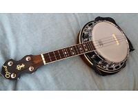 Ozark banjulele in very good condition with original Ozark hard shell case, strap & spare strings