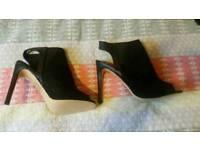 Black suede peep toe shoes