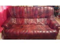real wood and dark red leather sofa in excellent condition