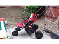 Double tandem buggy for sale. Red and black Hauck fan for kids.