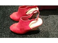 new unworn red wedge shoes