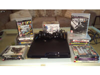 Playstation 3 console boxed,2 controllers and lots of games