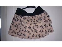 2 short skirts, size 10.