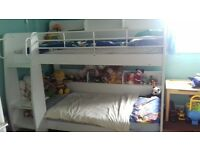 bunk bed with shelves without mattresses