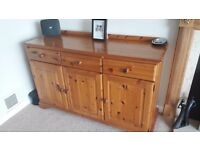 "Solid pine 3 drawer sideboard with single and double cupboard under. 54"" long x 19"" Deep x 33"" high"