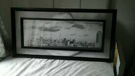 Black framed picture of skyline of new york