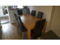 Solid Oak Dining Table with 6 Chocolate Leather Look Chairs
