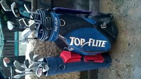 2 golf bags with clubs and balls see photos