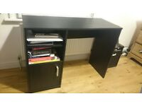 Office desk with two shelves and a small storage cupboard