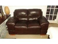 Dark brown 2 seater leather sofa.