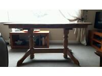 REDUCED Solid pine dining table with extendable middle part and 4 matching chairs.