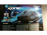 Roccat Kone+ Gaming mouse with all weights