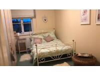 Double bed frame and mattress. Cream painted metal