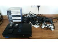PlayStation 2 with 14 Games. 3 x Controllers. 3 x Memory Cards