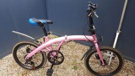 Folding pink ladies bike