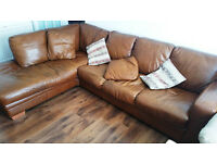 Big Brown Leather Left Hand Corner Sofa with cushions.