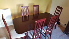 Extendable table and six chairs £195