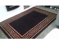 Large black and red rug.