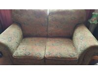 Comfortable two seater sofa looking for a new home (have two)