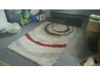 Fluffy white/red/brown rug