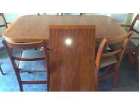 Solid yew dining table, 4 chairs two carvers.