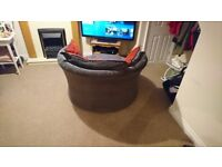 Red and grey swivel chair and foot stool