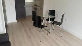 Glass round table with 4 chairs. Very good condition. Pick up only in London, E14