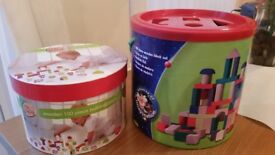2 tubs of assorted wooden building blocks